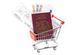 Travel money in shopping trolley cart passport flight boarding pass and euro notes a supermarket studio shot with a white Royalty Free Stock Photos