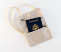 Travel neck pouch with passport on white background Stock Images