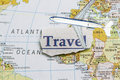 Travel newspaper cut out in a map Royalty Free Stock Photos