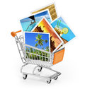 Travel photos in a shopping cart Royalty Free Stock Photo