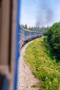 Travel, rest. View from the train window at the turn of the train, nature and trees. Vertical frame Royalty Free Stock Photo