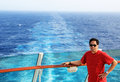 Travel by ship a handsome filipino or asian middle aged man posed a railing sailing in the middle of the ocean traveling via or Stock Photography