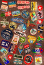 Travel stickers on the leather texture Royalty Free Stock Image