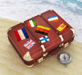 Travel suitcase on the beach Stock Image
