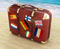 Travel suitcase on the beach Stock Photos
