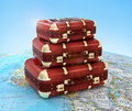 Travel suitcases in stack on global Royalty Free Stock Photos