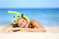 Travel summer vacation beach woman with snorkel smiling beautiful young relaxing lying on white sand in the sun Stock Image