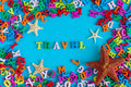 Travel text with starfishes and many color letters. Time to travel text written on photo frame, Summer time and vacation Royalty Free Stock Photo
