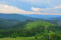 Travel to romania the scattered farms of bucovina on green fields are small country on beautiful green fields in heart moldova Royalty Free Stock Photos