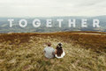 Travel together concept, text, happy gorgeous bride and groom si Royalty Free Stock Photo