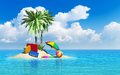 Travel tourism and vacations concept cases luggage umbrella beach ball lifebelt on lonely island with green palm trees Royalty Free Stock Photos