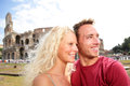 Travel tourists couple in love by colosseum rome traveling romantic tourist on holidays vacation europe beautiful blonde Royalty Free Stock Image