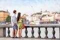 Travel tourists people taking photos in stockholm europe tourist pictures couple smartphone having fun enjoying skyline Stock Image