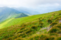 Travel, trekking, nature. Majestic, high green mountains. Horizontal frame Royalty Free Stock Photo