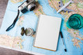 Travel trip vacation tourism mockup tools close up of compass glass of water note pad pen and toy airplane and touristic map on Royalty Free Stock Images
