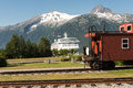 Travel vintage caboose and and modern cruiseship in skagway alaska Royalty Free Stock Photography