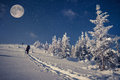 Travel in winter mountains at the night with stars and a full moon Royalty Free Stock Photo