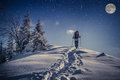 Travel in winter mountains at night Royalty Free Stock Photo