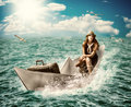 Travel woman with luggage on boat concept dreaming about sea ​​cruise around the world floats the paper the ocean Royalty Free Stock Image