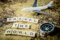 Travel the world concept scrabble text and traveler equipment Royalty Free Stock Photo