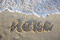 Travel Written in sand at the beach. Royalty Free Stock Photo