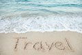 Travel Written On Sand By Sea Royalty Free Stock Photo