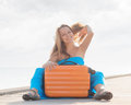 Travel young woman sitting on wooden pier Royalty Free Stock Images