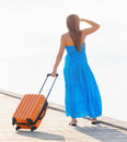 Travel young woman with suitcase on the pier Stock Photos
