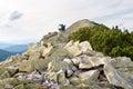 Traveler climbing to the mountain top