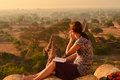 Traveler enjoy sunset in bagan myanmar Stock Photos