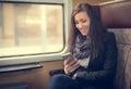 Traveler girl use the phone on train Royalty Free Stock Photo