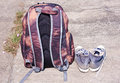 Traveler horizontal image in concept to show by backpack and canvas shoes on the road that someone prepare to travel Stock Photos