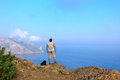 Traveler looks at the beautiful seascape from the mountain top crimean of karaul oba sudak crimea ukraine Stock Photos