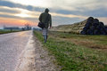 Traveler male walks on old road at countryside Royalty Free Stock Photos