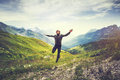 Traveler Man jumping with mountains landscape on background Royalty Free Stock Photo
