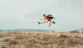 Traveler Man Jumping On Nature