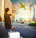 Traveler man and luggage standing on traffic and looking to time watch against passenger car airplane flying above Royalty Free Stock Photos