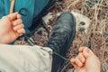 Traveler Man Tying Shoelaces O...