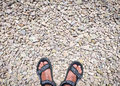 Traveler's feet on stone paved road wearing sandals Royalty Free Stock Photo