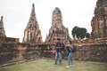 Traveler and tourist asian man and women with backpack walking in temple Ayuttaya ,Thailand.