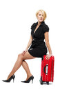 Traveler woman sit on suitcase white Stock Photos