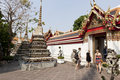 Travelers enjoy sightseeing at wat pho bangkok thailand feb unidentified on february in bangkok thailand also known as the Stock Photos