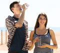 Travelers having a rest and drinking cold water Royalty Free Stock Photo