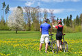 Travelers with mountain bikes in a meadow Stock Photo
