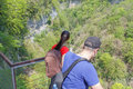 Travelers travel on the artificial roadway In the mountains canyon. Trekking together