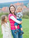 Travelers. Young mother with her two children Royalty Free Stock Photo