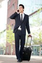 Traveling businessman talking on mobile phone portrait of a Stock Photos