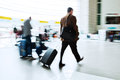 Traveling businessmen at the airport in motion blur Royalty Free Stock Photography