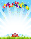 Traveling circus under blue sky and bunch of balloons Royalty Free Stock Images