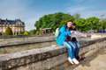 Traveling couple sitting with a map young in front of the invalides complex in paris Stock Photography